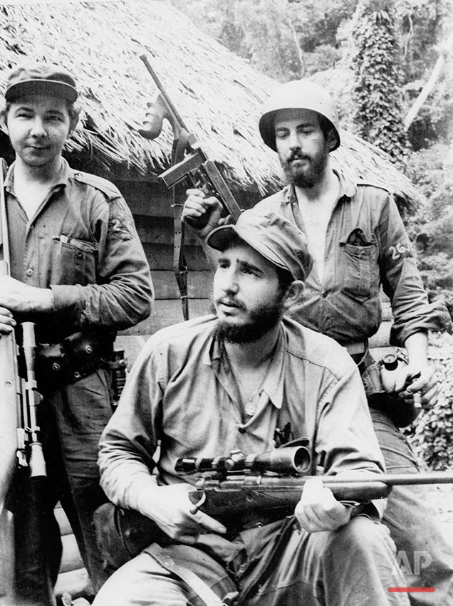 In this March 14, 1957 photo, Fidel Castro, the young anti-Batista guerrilla leader, center, is seen with his brother Raul Castro, left, and Camilo Cienfuegos, right, while operating in the Mountains of Eastern Cuba. The man who nationalized the Cuban economy and controlled of virtually every aspect of life on the island celebrates his 90th birthday on Saturday. Aug. 13, 2016, in a far different country than the one he ruled for decades. (AP Photo/Andrew St. George)