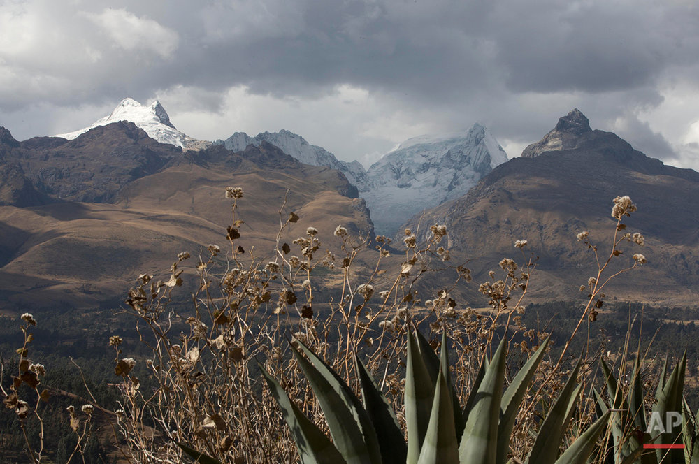 In this Aug. 12, 2016, a glacier is seen in the Huascaran National Park in Huaraz, Peru. Peru has 70% of the world's tropical glaciers and is facing imminent water resource issues while the glaciers retreat. (AP Photo/Martin Mejia)