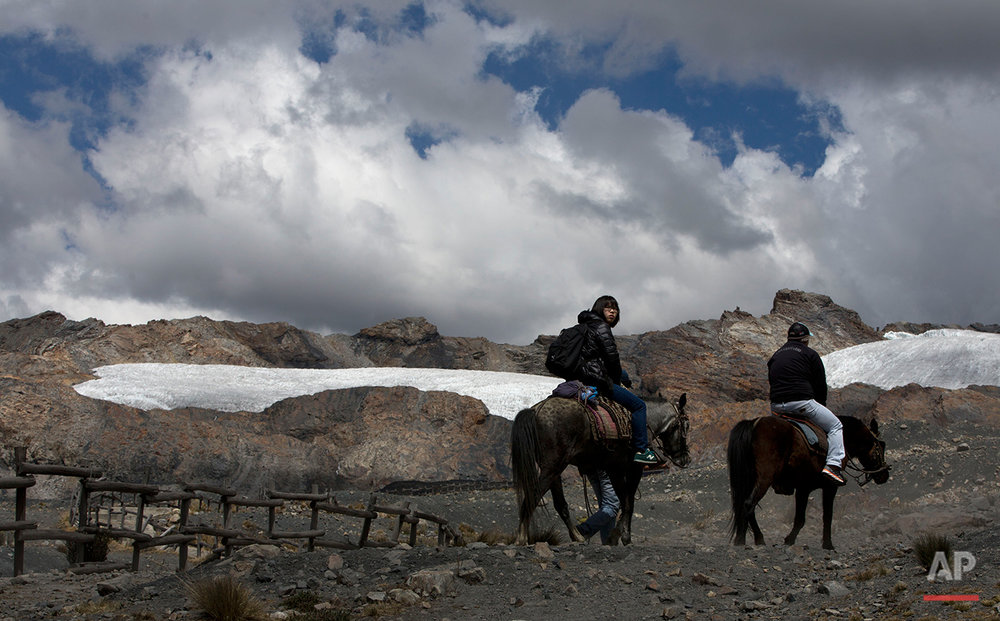 "In this Aug. 12, 2016 photo, a group of tourists ride horses to the Pastoruri glacier in a tour called ""The Route of Climate Change"" in Huaraz, Peru. The tropical glaciers of South America are dying from soot and rising temperatures, threatening water supplies to communities that have depended on them for centuries. (AP Photo/Martin Mejia)"