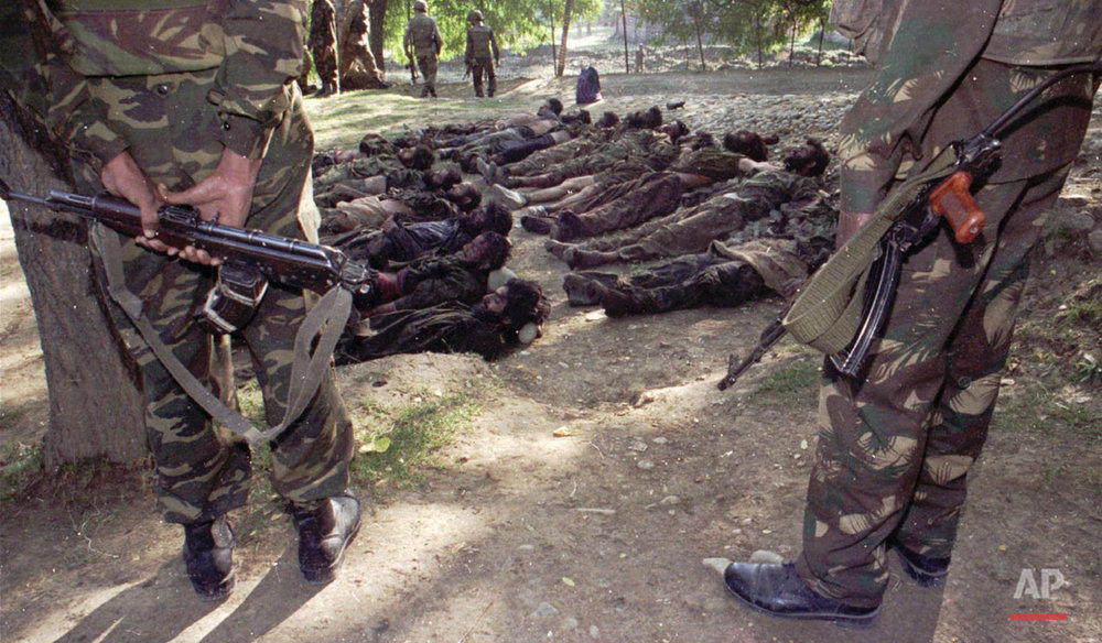 The Bodies of 16 militants lie in an Indian Army camp in Beerwah village, 40 kms from Srinagar in central Kashmir Monday, September 22, 1997. The sixteen militants, including 14 foreign nationals, were killed in an encounter with the Indian Army in Latun village 47 kms from Srinagar Sunday. Militants in Kashmir are fighting with Indian security forces to liberate Kashmir from India.(AP Photo/Aijaz Rahi)
