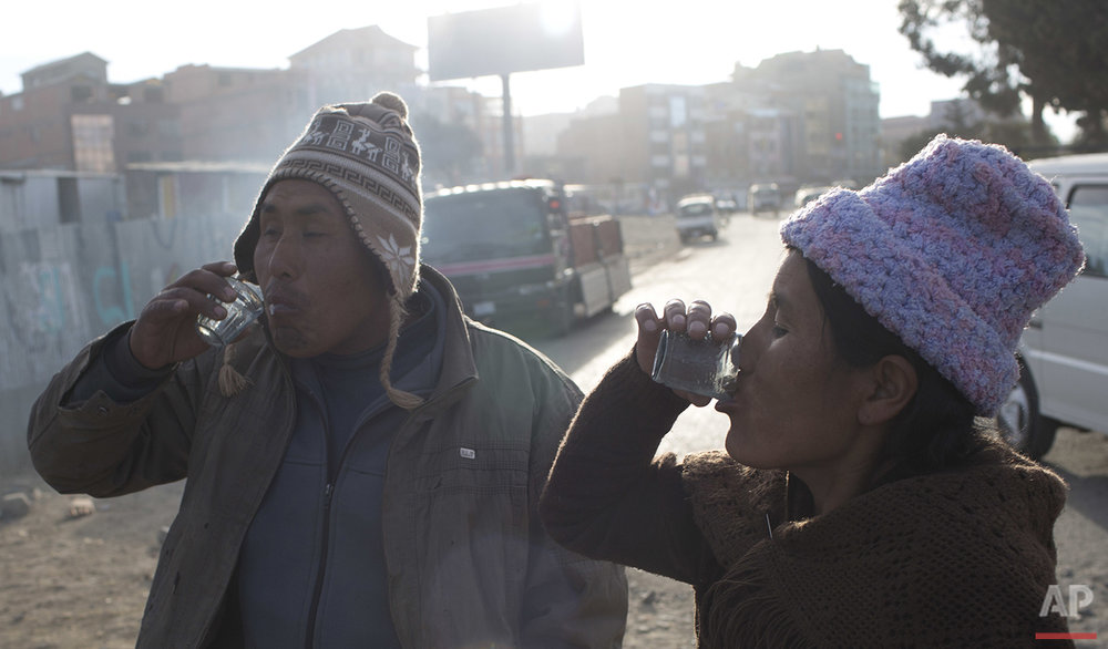 "In this June 8, 2016 photo, Lorenzo Saldias and his wife drink donkey milk from a vendor in the streets of El Alto, Bolivia. ""Donkey milk is medicine that heals,"" Salvias said. ""I had pneumonia, my back hurt and I had the chills. Now it's taking effect. I drink it with my wife."" (AP Photo/Juan Karita)"
