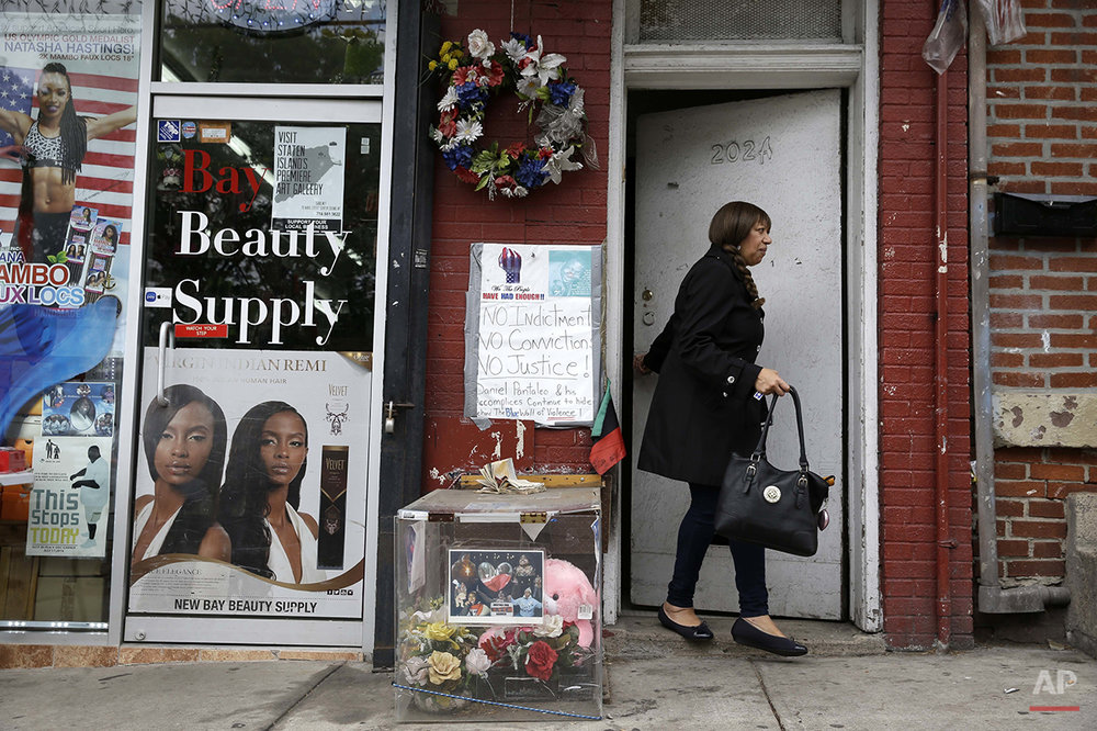 This Tuesday, May 24, 2016 photo shows a memorial at the site of Eric Garner's death in the Staten Island borough of New York. The 43-year-old black man died in July 2014 after a white police officer placed him in a chokehold during an arrest for selling loose cigarettes. A grand jury declined to indict the officer who put Garner in the hold or any of the other officers involved in the arrest. The city agreed to pay a $5.9 million civil settlement. (AP Photo/Seth Wenig)