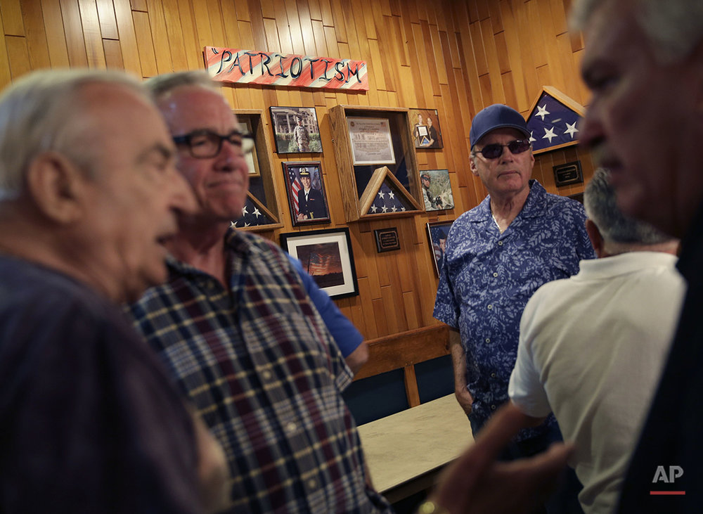Members of the NYC Verrazano 10-13 Association, made up of retired police officers, gather during a meeting in the Staten Island borough of New York, Wednesday, June 15, 2016. Some of the members lament today's policing climate, even as they wax about the old days. Combine officers lacking street savvy and people in minority neighborhoods who mistrust them and policing is much tougher, says Richard Commesso, a retired detective. He credits his long-ago partner, a black cop, with schooling him to the ways of the neighborhoods they patrolled. (AP Photo/Seth Wenig)