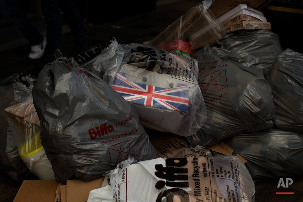 In this Saturday, July 2, 2016 photo, a box decorated with a Great Britain's union flag lays inside a rubbish bag in downtown Glasgow, Scotland. In one of the defining splits of last week's EU referendum, all 32 council areas in Scotland as well as Northern Ireland voted for Britain to stay in the bloc. Even towns shattered by the demise of shipyards, coal mines and steelworks made the calculus that quitting the EU wouldn't turn things around for them. (AP Photo/Emilio Morenatti)