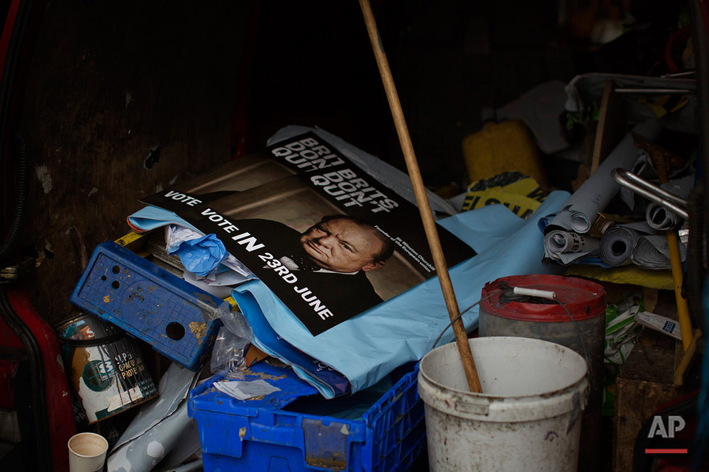 In this Friday, July 1, 2016 photo, a poster with a photo of Winston Churchill, calling for 
