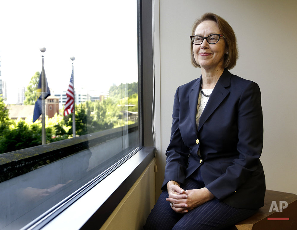 Oregon Attorney General Ellen Rosenblum poses for a photo at her office in Portland, Ore., Wednesday, July 13, 2016. She says a support network has been instrumental throughout her career, beginning as a lawyer in Oregon and continuing as she was appointed a state court judge and later during her successful bid for state attorney general. Two of her early mentors were former Oregon Supreme Court Justice Betty Roberts, the first woman to serve on an Oregon appellate court, and Barbara Roberts, the first woman elected governor of Oregon. (AP Photo/Don Ryan)