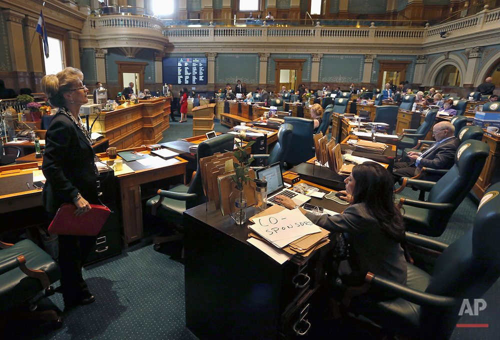 In this Wednesday May 6, 2015 photo, legislators wait for a bill to be brought to the floor in the state house on the closing day of the 2015 Colorado legislative session at the Capitol in Denver. Colorado has the highest number of women serving in a state legislature, with 42 percent, but it has never had a woman governor or U.S. senator. (AP Photo/Brennan Linsley)