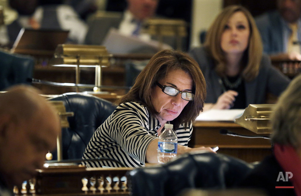 In this Monday, Jan. 11, 2016, photo, New Jersey Assemblywoman Pamela R. Lampitt, D- Voorhees, N.J., casts her vote during an Assembly session at the Statehouse, in Trenton, N.J. While New Jersey is making progress toward getting more women involved in politics, analysts and female lawmakers say much more can and should be done to increase the number of women who hold elected office. Only 36 of 120 seats in the state Legislature are held by women. (AP Photo/Mel Evans)