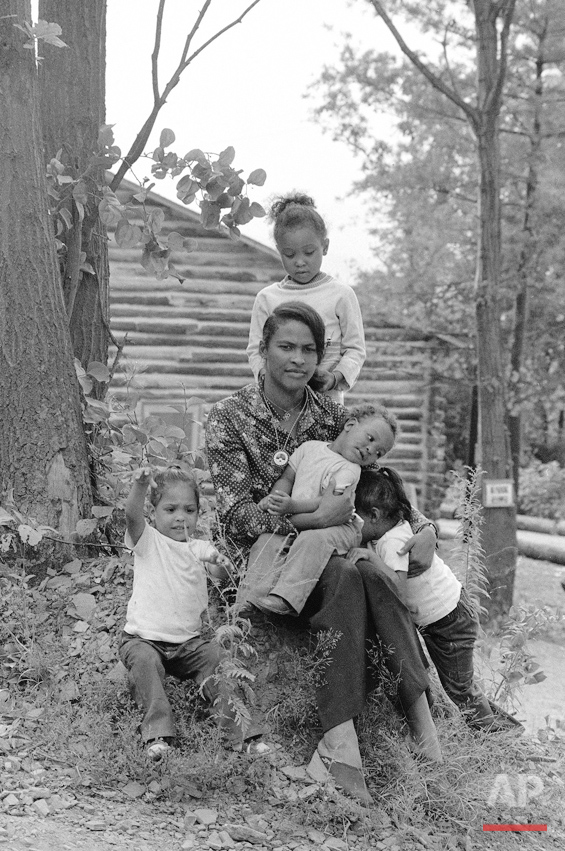 Khalilah Ali, second wife of former heavyweight champion Muhammad Ali, sits surrounded by their children at Ali's training camp at Deer Lake, Pa., Aug. 21, 1973.  Shown are:  Muhammad Jr. in mom's lap; Maryum, standing; and twins Reesheda, left, and Jamillah.  Khalilah is the former Belinda Boyd.  (AP Photo)