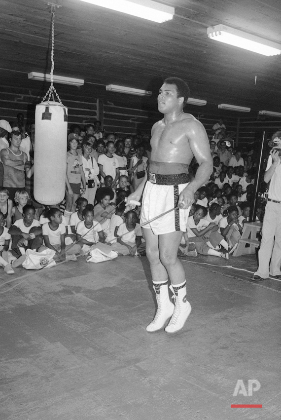 "Muhammad Ali trains on Sept. 16, 1978 at his Deer Lake, Pa., camp for comeback bout with Leon Spinks in New Orleans on September 15. Ali, who claims he was out of shape for the last heavyweight title match with Spinks, says he will be in top form for the next one and plans to make ""real history"" by regaining the title for an unprecedented third time. (AP Photo/Dave Pickoff)"