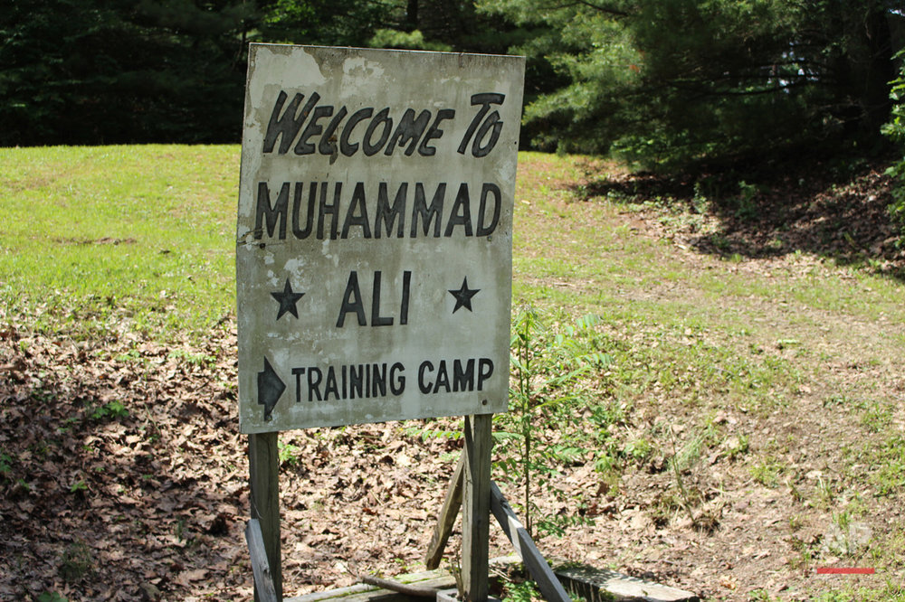 In this photo taken Monday, June 6, 2016, a sign is displayed outside  Muhammad Aliís training camp in Deer Lake, Pa. Since Aliís death at 74, residents have been coming to the rustic hilltop camp to pay their respects. (AP Photo/Michael Rubinkam)