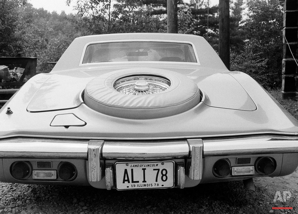 Rear view and vanity plates of heavyweight boxing champ Muhammad Ali's car, shown at his training retreat in Deer Lake, Penn., Aug. 14, 1978. (AP Photo/Dave Pickoff)