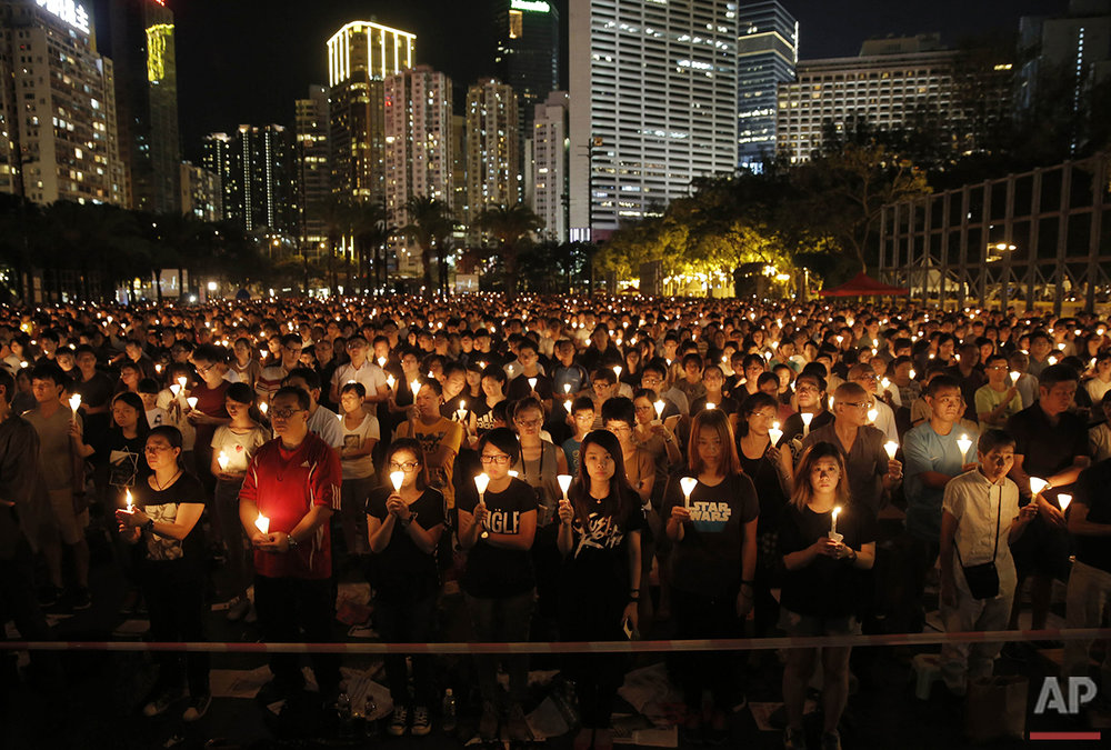 Tens of thousands attend a candlelight vigil at Victoria Park in Hong Kong, Saturday, June 4, 2016, to commemorate victims of the 1989 military crackdown in Beijing. China's bloody crackdown on the Tiananmen Square pro-democracy protests was a pivotal moment in the country's political development. Despite the Communist Party's efforts to erase memories of the event, every year its anniversary triggers heightened security and surveillance on the mainland, along with furtive commemorations by a handful of activists. (AP Photo/Kin Cheung)