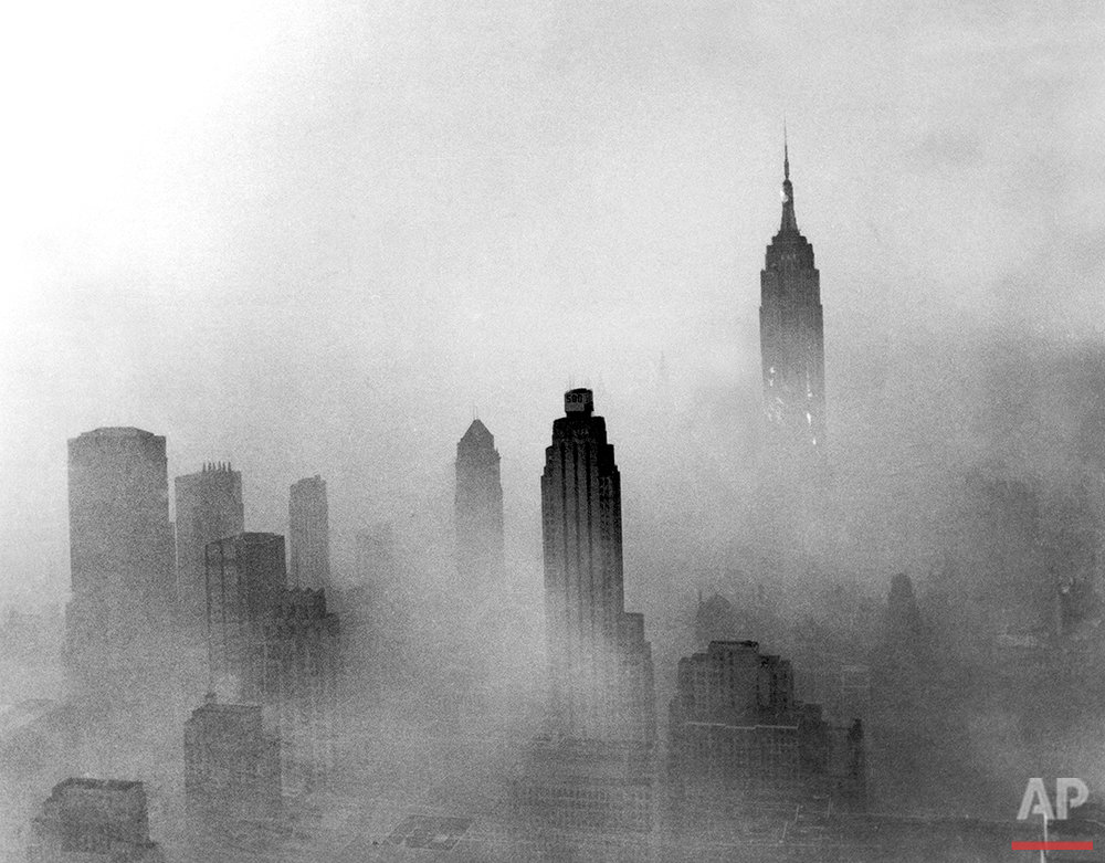 The Empire State Building is visible in a hazy New York City skyline, circa 1969-1970. (AP Photo/Eddie Adams)