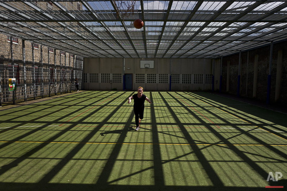In this Wednesday, April 20, 2016 photo, Mongolian migrant Naaran Baatar, 40, plays basketball at a yard of the former prison of De Koepel in Haarlem, Netherlands. (AP Photo/Muhammed Muheisen)