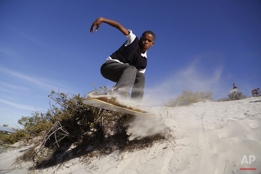 APTOPIX South Africa Sandboarding Boys