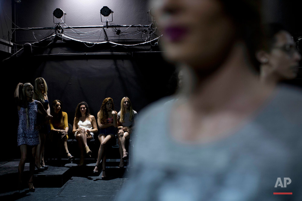 In this Tuesday, May 24, 2016 photo, contestants in the first Miss Trans Israel beauty pageant, practice the walk on the stage during rehearsal in Tel Aviv, Israel. The pageant will be held at HaBima, Israel's national theater, in Tel Aviv on Friday. Tel Aviv has emerged as one of the world's most gay-friendly travel destinations, standing in sharp contrast to most of the rest of the Middle East, where gays can face persecution. (AP Photo/Oded Balilty)