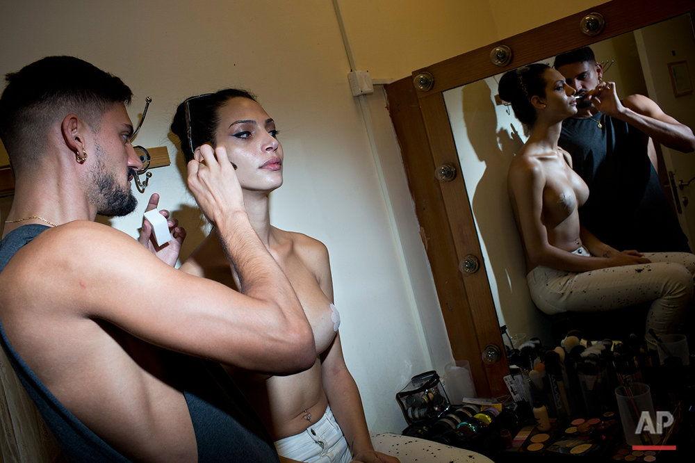 Talleen Abu Hanna, a contestant gets her makeup ready backstage during the first Miss Trans Israel beauty pageant at HaBima, Israel's national theater in Tel Aviv, Israel, Friday, May 27, 2016. Talleen Abu Hanna, 21, an Israeli from a Catholic Arab family has been crowned the winner of the country's first transgender pageant.(AP Photo/Oded Balilty)