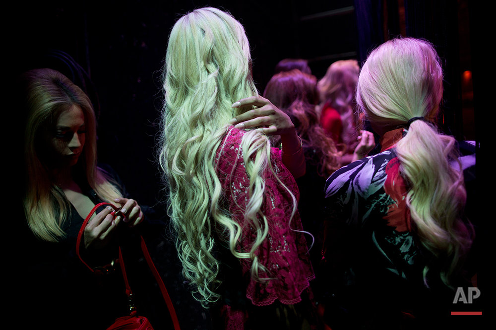 Contestants wait for their run backstage during the first Miss Trans Israel beauty pageant at HaBima, Israel's national theater in Tel Aviv, Israel, Friday, May 27, 2016. Talleen Abu Hanna, 21, an Israeli from a Catholic Arab family has been crowned the winner of the country's first transgender pageant.(AP Photo/Oded Balilty)
