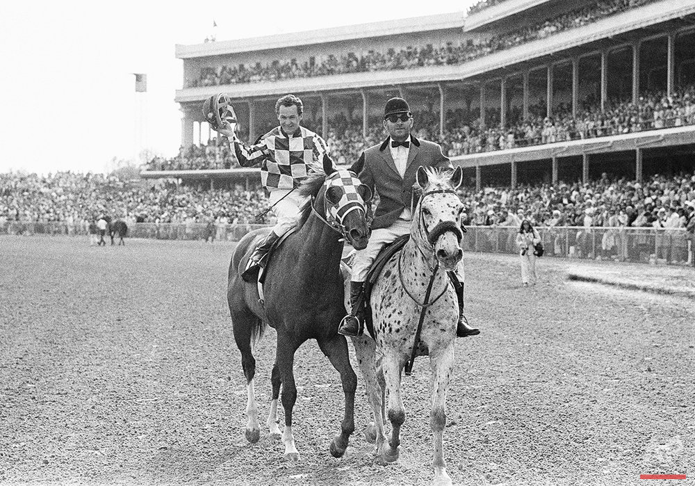 Jockey Ron Turcotte in Winner's Circle at Churchill Downs in Louisville, Ky., May 5, 1973, after Turcotte rode Secretariat to a record win in the 99th Kentucky Derby. (AP Photo)