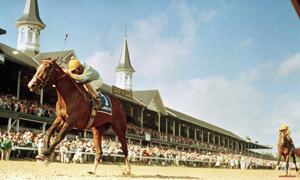 Unbridled, with jockey Craig Perret in the irons, passes the landmark spires at Churchill Downs on his way winning the Kentucky Derby, Saturday, May 5, 1990. (AP Photo/Bob Daugherty)