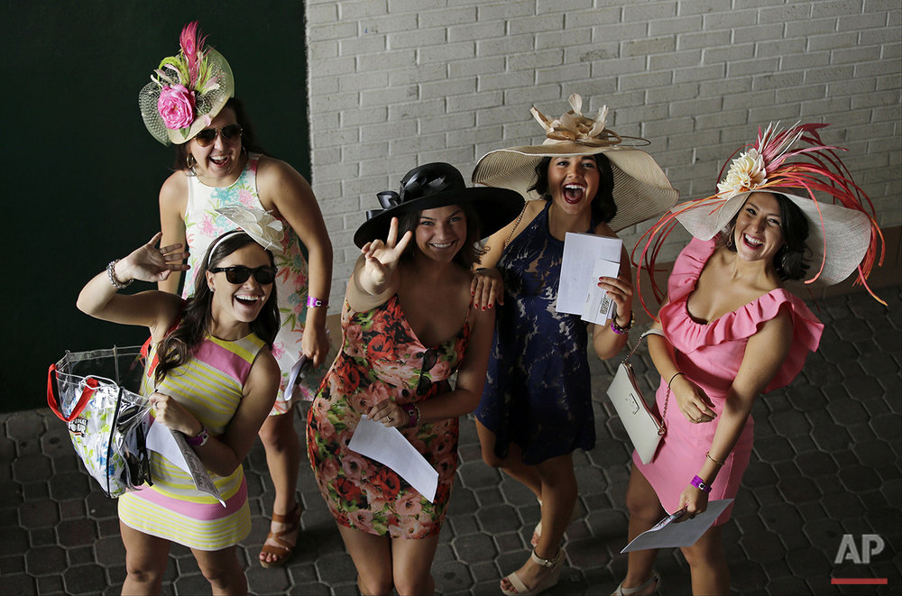 Fans arrive for the 141st running of the Kentucky Derby horse race at Churchill Downs, Saturday, May 2, 2015, in Louisville, Ky. (AP Photo/Matt Slocum)