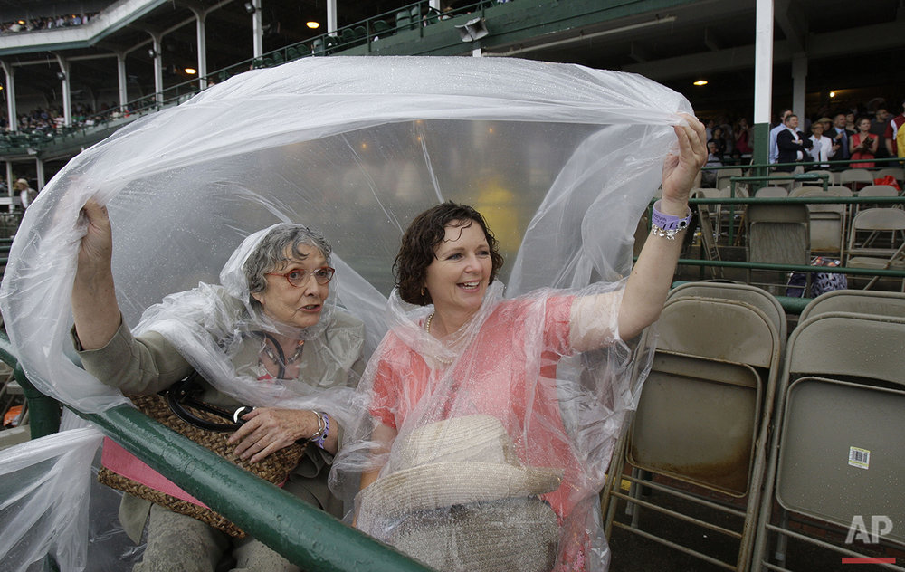 Jean McKierman, left, and Charlotte Wilson, of Hot Springs, Ark., watch the sixth race at Churchill Downs Friday, May 2, 2008, in Louisville, Ky. (AP Photo/Darron Cummings)