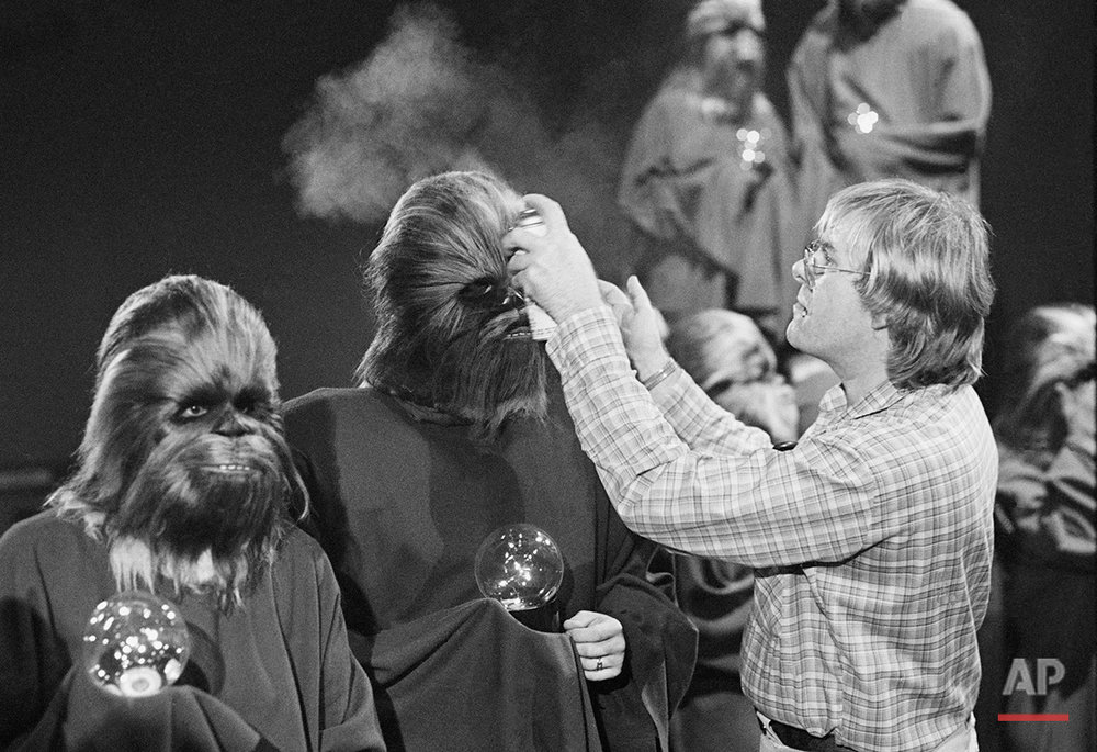 """An """"extra"""" Wookie has his hair sprayed by a makeup artist during the taping of the television special for the holidays made by the cast of the movie """"Star Wars"""" Wednesday Oct. 5, 1978 in Los Angeles. The Wookie planet is visited in the episode.(AP Photo/Brich)"""
