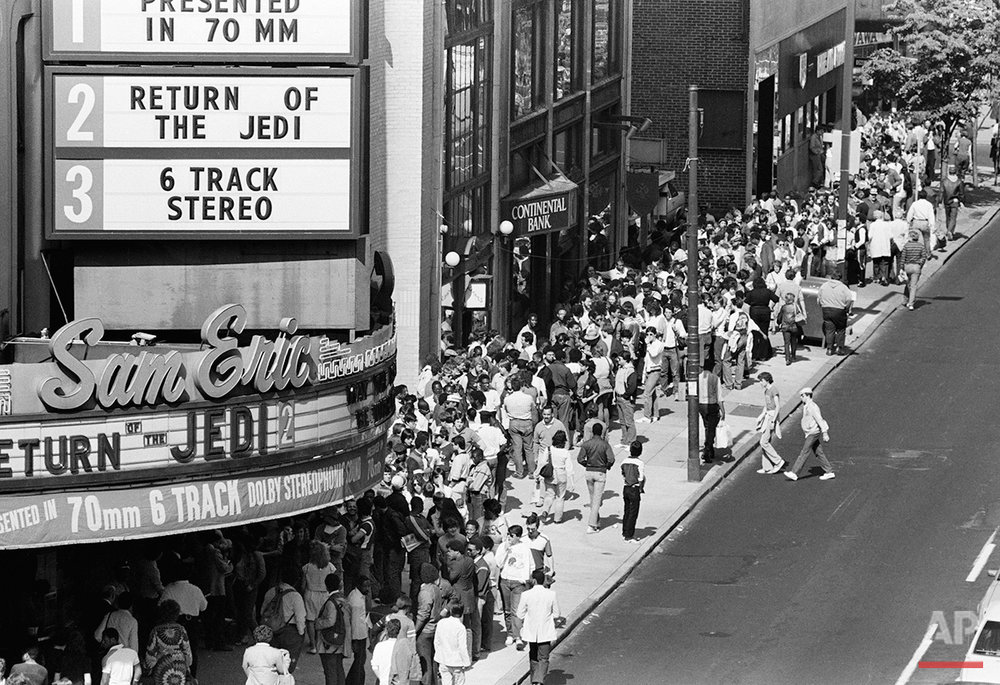 """Movie fans line up on Philadelphia's Chestnut Street for the premiere of the Movie """"Return of the Jedi"""" Wednesday May 23, 1983. Fans began lining up Tuesday night to see the Star Wars trilogy. (AP Photo/ George Widman)"""