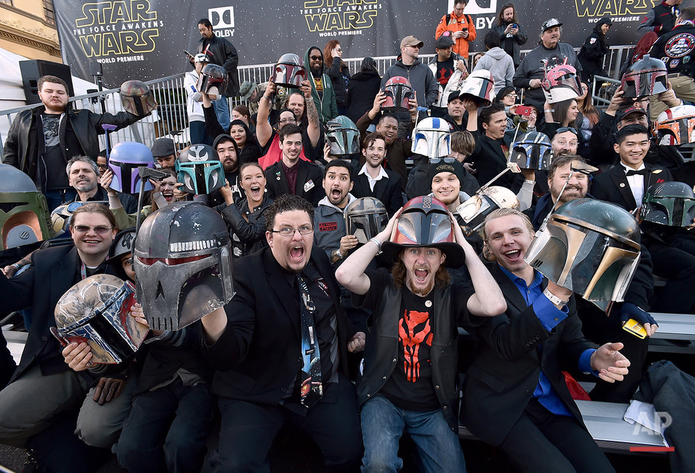 """In this Monday, Dec. 14, 2015 photo, fans cheer in the stands at world premiere of """"Star Wars: The Force Awakens"""" at the TCL Chinese Theatre in Los Angeles. Early screenings of the film begin Thursday night, Dec. 17, 2015. (Photo by Jordan Strauss/Invision/AP)"""