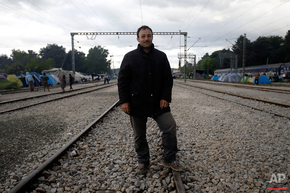 Syrian Ziad Alli poses for a portrait on the tracks of a rail way station which was turned into a makeshift camp crowded by migrants and refugees at the northern Greek border point of Idomeni, Greece, Tuesday, May 3, 2016. (AP Photo/Gregorio Borgia)