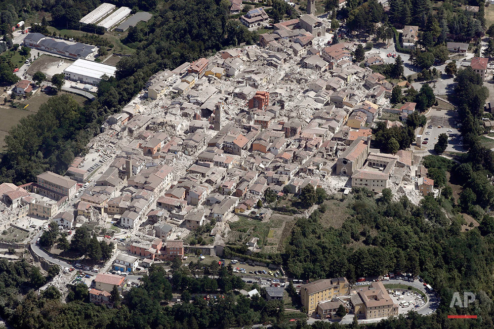 This aerial photo shows the damaged buildings in the historical part of the town of Amatrice, central Italy, after an earthquake, Aug. 24, 2016.  (AP Photo/Gregorio Borgia)