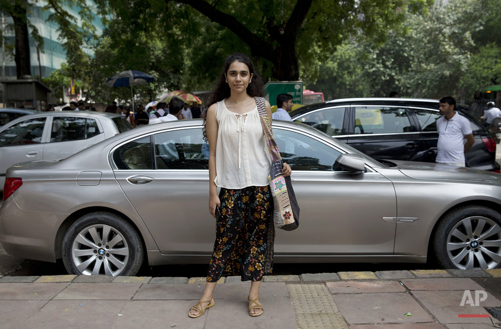 "Antara Rao, a student at Delhi University, poses for a photograph in New Delhi, India, on Monday, Aug. 1, 2016. On the United States, she says, ""I think everyone is very tolerant there, in a way that there are all kinds of people, whether from different ethnicities, different countries, different religions. People are mostly not concerned with what another (person) is doing. There was a bit of a culture shock when I first went there because the way people dress there is very much different from the way we dress here. All of them wear shorts."" (AP Photo/Tsering Topgyal)"