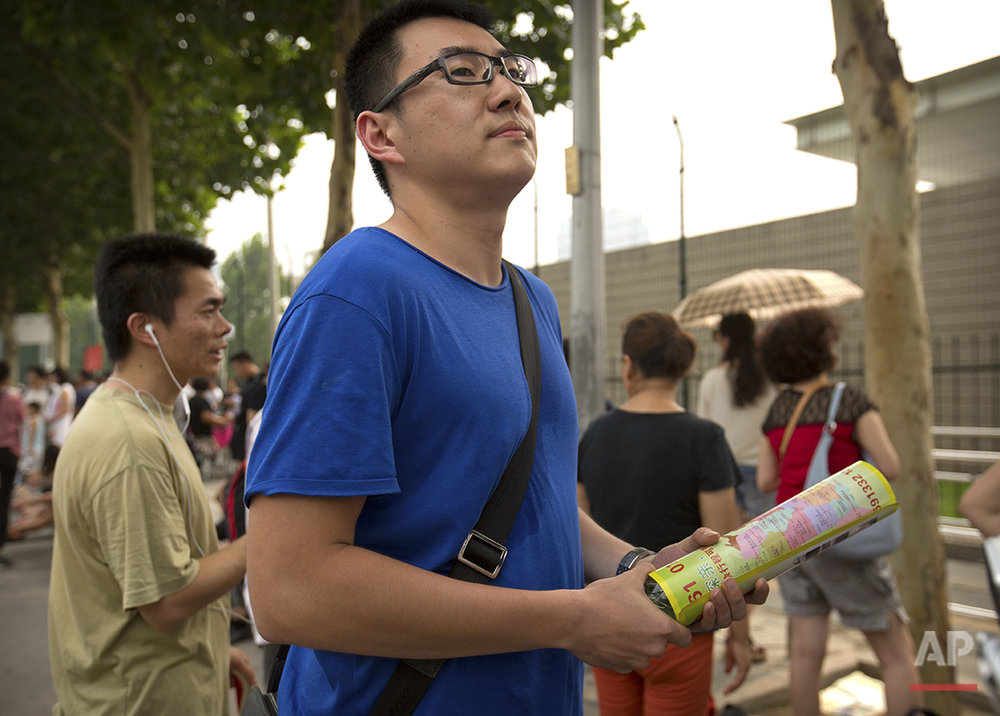 "Sam Wang, 20, a university student, stands outside the U.S. embassy in Beijing on Friday, July 29, 2016. ""America is a country that produces a massive amount of cultural output such as Hollywood movies, music and many other (forms of) entertainment,"" he says. (AP Photo/Mark Schiefelbein)"