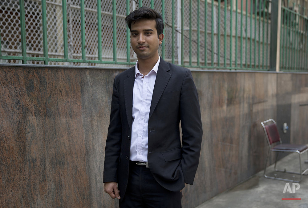 "Shitij, 26, in sales and marketing in the hotel industry, poses for a photo in New Delhi, India, on Monday, Aug. 1, 2016. ""America is a land of opportunities. I think that anybody with good ideas, if they want to make a mark, it gives you an equal opportunity in that country. America stands out because people recognize merit out there,"" he says. (AP Photo/Tsering Topgyal)"