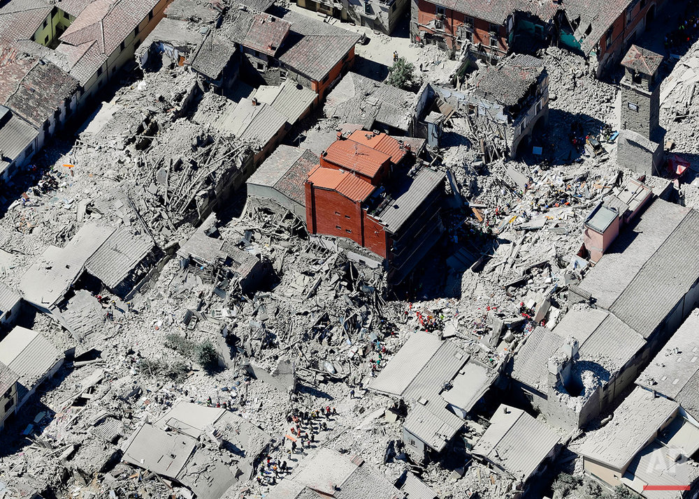 This aerial photo shows the earthquake-decimated historical area of Amatrice, Italy, Wednesday, Aug. 24, 2016. The deadly quake struck earlier in the morning and was felt across a broad swath of central Italy, including Rome. (AP Photo/Gregorio Borgia)