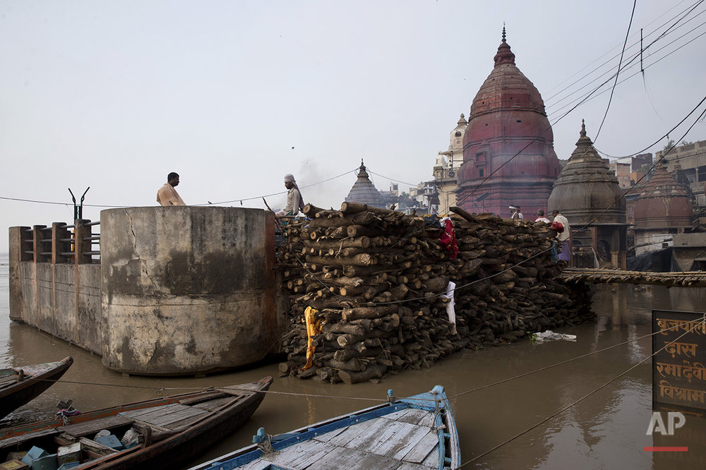A thin line of smoke rises from burning funeral pyres on a rooftop of a temple at the flooded Manikarnika Ghat in Varanasi, India, Saturday, Aug. 27, 2016. As the mighty Ganges River overflowed its banks this past week following heavy monsoon rains, large parts of the Hindu holy town of Varanasi were submerged by floodwaters, keeping away thousands of Hindu devotees. Varanasi is a pilgrim town that Hindus visit to take a dip in the holy Ganges. (AP Photo/Tsering Topgyal) See these photos on  APImages.com