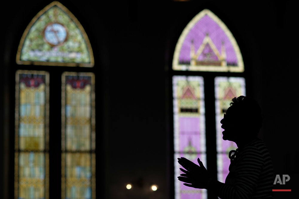 """Parishioner Bea Warbington-Ross sings during a worship service at First Baptist Church, a predominantly African-American congregation, in Macon, Ga., on Sunday, July 10, 2016. The retired human resources specialist says, """"There's no reason for Sunday to be the most segregated day."""" (AP Photo/Branden Camp)"""