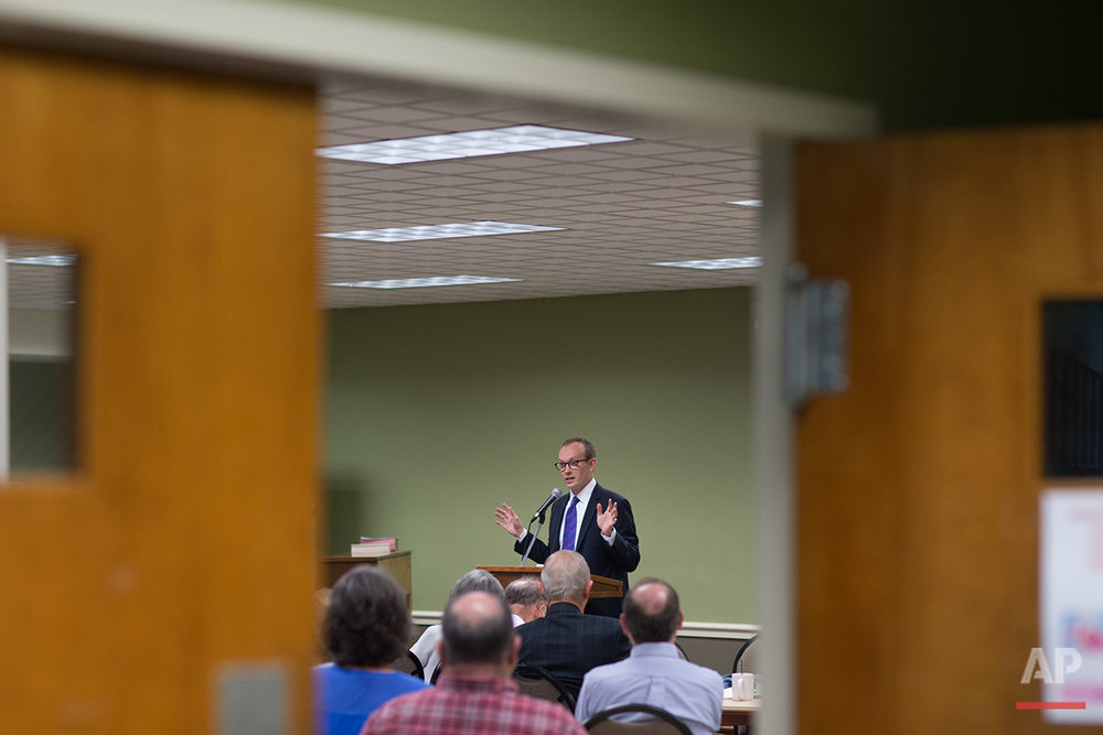 """The Rev. Scott Dickison teaches from a book of sermons by Martin Luther King Jr. during a Sunday School class at the First Baptist Church of Christ, a predominantly white congregation, in Macon, Ga., on Sunday, July 10, 2016 - days after the fatal police shootings of Alton Sterling in Louisiana and Philando Castile in Minnesota, and the fatal ambush on Dallas police. """"It's weeks like these when we need more than ever to be with God's people,"""" Dickison told the roomful of congregants. (AP Photo/Branden Camp)"""
