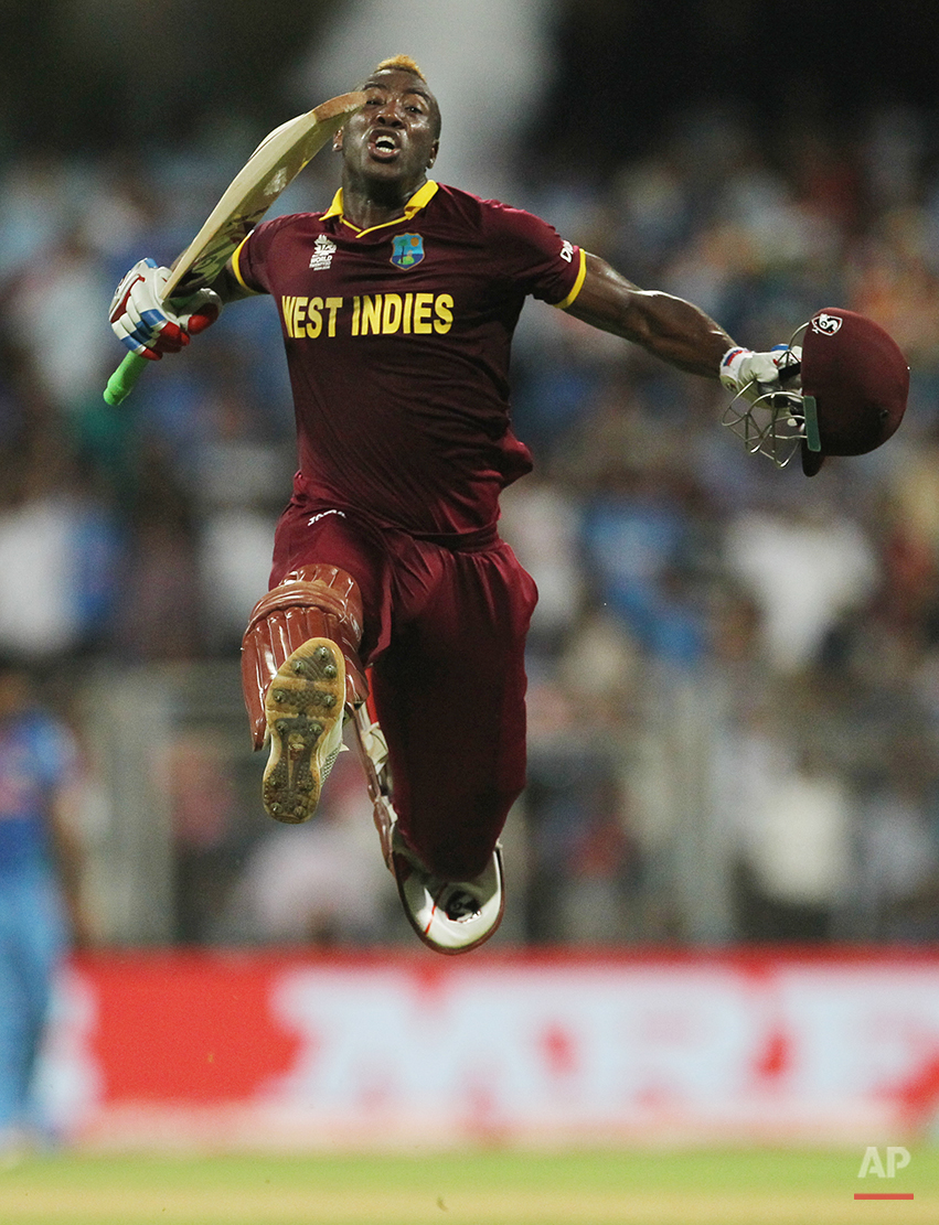West Indies Andre Russell celebrates after his team's seven wicket win over India during their ICC World Twenty20 2016 cricket semifinal match at Wankhede stadium in Mumbai, India,Thursday, March 31, 2016.(AP Photo/Rafiq Maqbool)