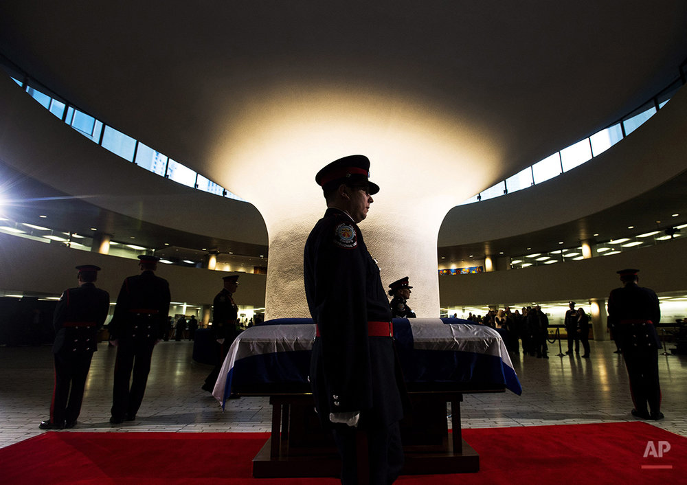 An honor guard stands by former Toronto Mayor Rob Ford's casket at city hall on Monday, March 28, 2016, in Toronto. Ford died of cancer at the age of 46. (Nathan Denette/The Canadian Press via AP)