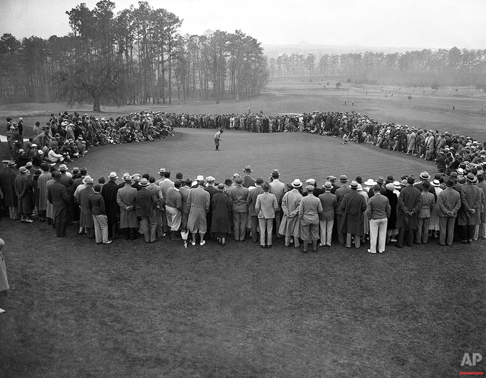 Bobby Jones misses a 20-foot putt, by an inch, on the green in second round play at the inaugural Augusta National Invitational Tournment in Augusta, Ga., on March 23, 1934. Jones scored a round total of 150. (AP Photo)