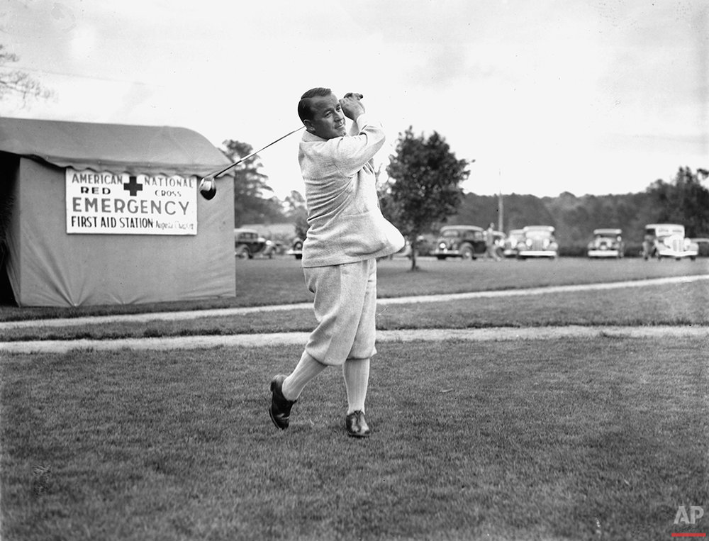 Gene Sarazen is shown driving the ball during the opening at the Augusta National Tournament in Augusta, Ga., on April 4, 1935. (AP Photo)