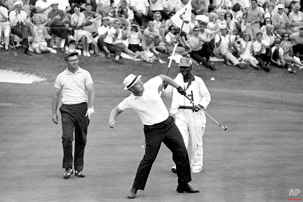 Jack Nicklaus winds up as he is about to toss his ball down the fairway after he putted out to win the Masters Championship at Augusta National Golf Club in Augusta, Ga. on April 11, 1965. He fired a record score of 271, 17 strokes under par. (AP Photo)
