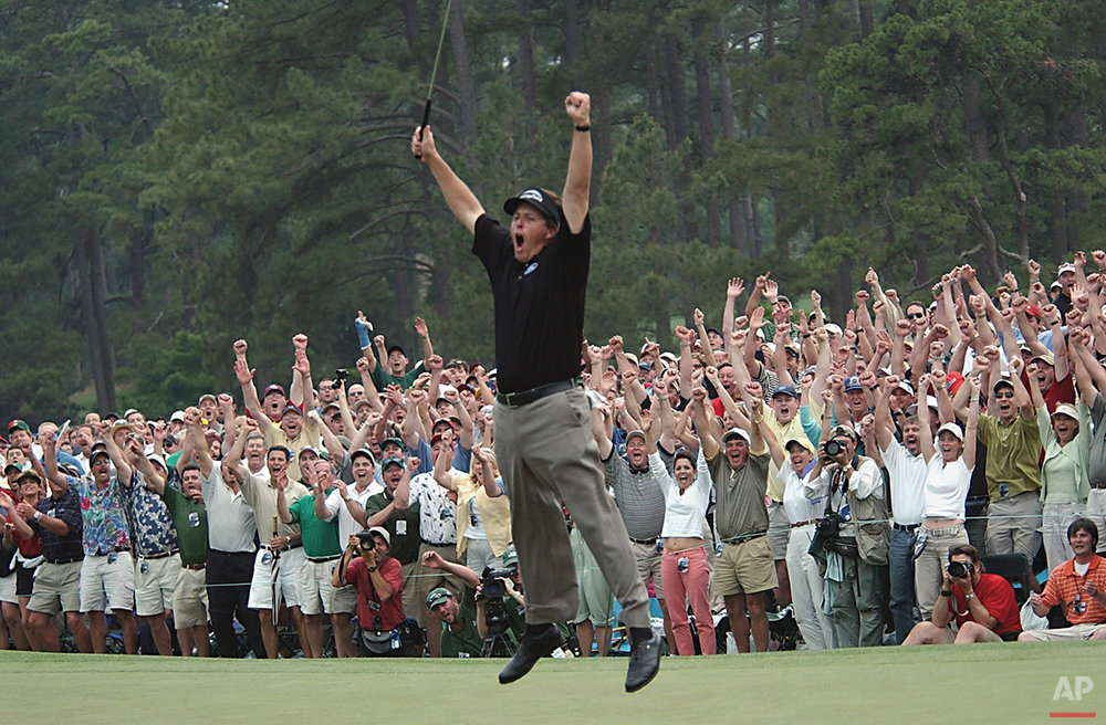 Phil Mickelson celebrates after winning the Masters golf tournament at the Augusta National Golf Club in Augusta, Ga., in this April 11, 2004 photo. (AP Photo/Dave Martin)