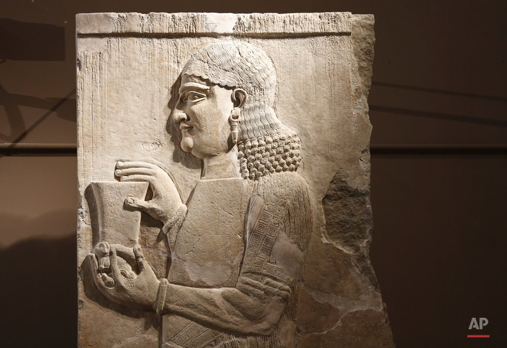 In this Sunday, March 13, 2016 photo, a detail of a stone wall panel fo at the Assyrian Hall of the Iraq National Museum Baghdad. Assyria was a civilization located near the modern-day city of Mosul, now held by the Islamic State group, who published videos online showing the destruction of key Assyrian sites Nimrud and Hatra along with many other religious and cultural sites. (AP Photo/Maya Alleruzzo)