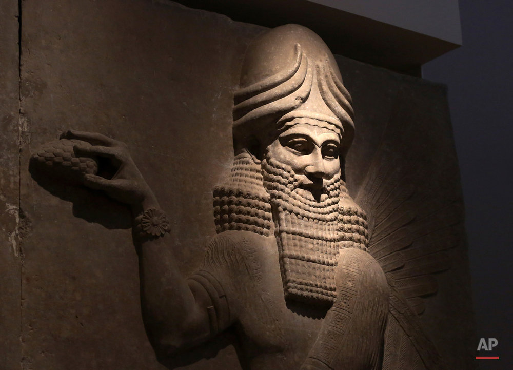 In this Wednesday, July 29, 2015 photo, an Assyrian artifact is displayed at the Iraqi National Museum in Baghdad, Iraq. After the destruction wreaked on archaeological sites by Islamic State group, the collections at the Iraq's National Museum in Baghdad have become even more important. It's now one of the places you can find relics from ancient cities that fell into the extremists' hands.(AP Photo/Khalid Mohammed)