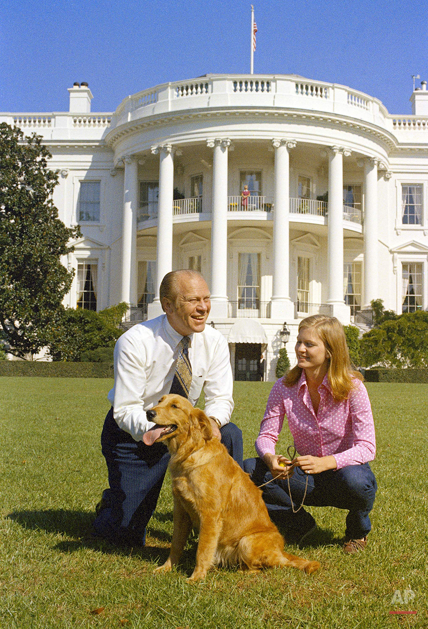 This Oct. 7, 1974 photo shows President Gerald Ford and his daughter, Susan, on the South Lawn of the White House with their dog, Liberty. (AP Photo)