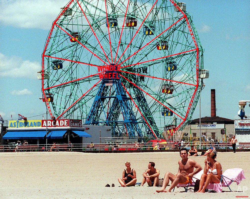 Beach goers take advantage of temperatures that reached into the mid-70's Friday, May 26, 2000, at New York's Coney Island. (AP Photo/Ed Bailey)