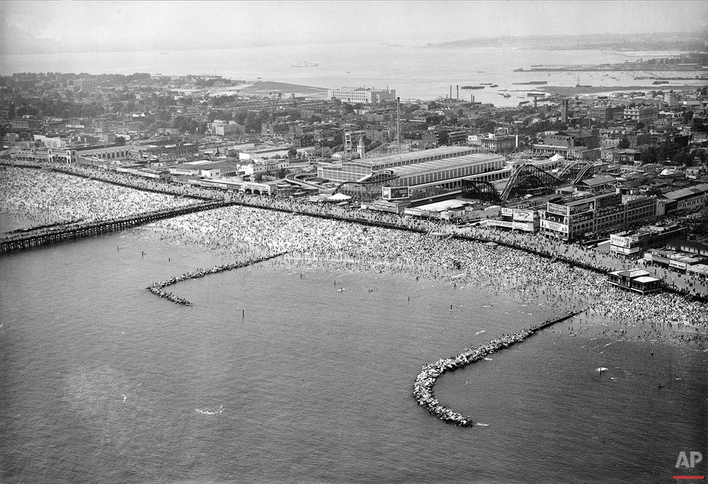 This aerial view shows the huge crowd that fills the water and beach at Coney Island in Brooklyn, N.Y., on Independence Day, July 4, 1937. (AP Photo)